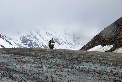 6/6/08 12:26 PM - An FJR1300 at the top of Atigun Pass, riding through a mixture of snow and rain.
