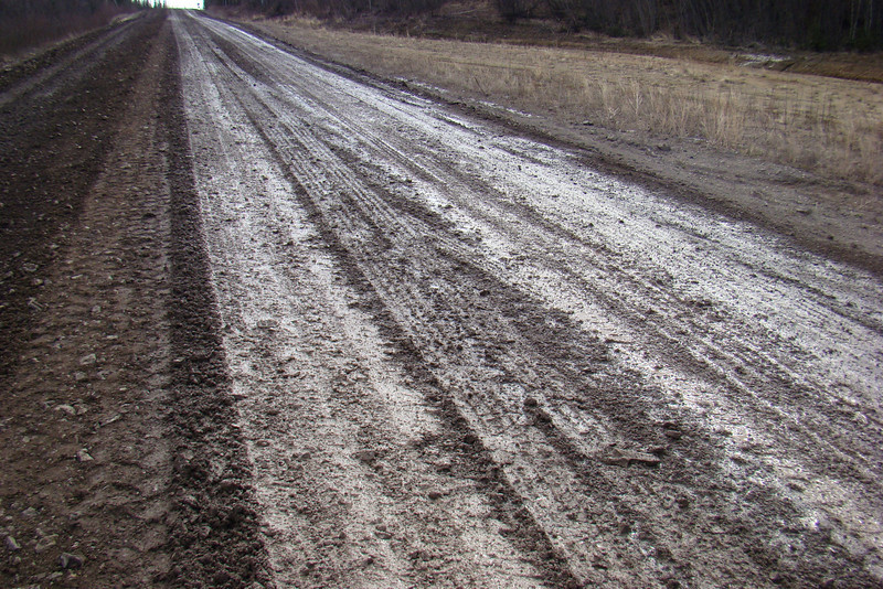 """Again at Milepost 30, a closer look at the road surface as it undergoes """"maintenance"""" grading."""