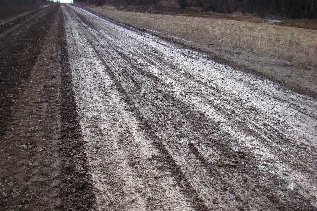 "Again at Milepost 30, a closer look at the road surface as it undergoes ""maintenance"" grading."