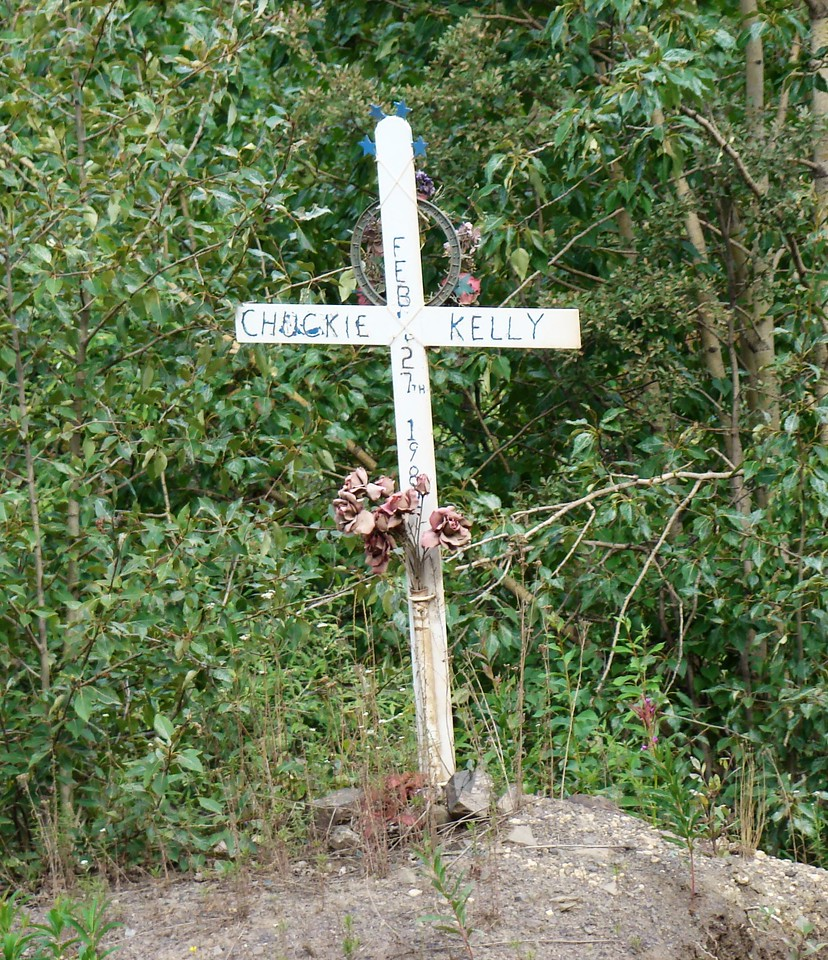 This cross marks the spot where Chuckie Kelly met his end, February 27, 1982.