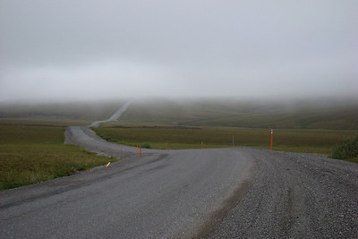 8:37AM 8/10/08 - Peeking under the clouds while gazing south from about Mile 354 of the Dalton Hwy.  At least the pavement is in good shape here.