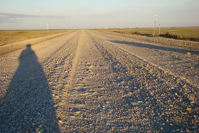 7/5/08 1:15 AM - This is what the road surface looks like for much of the last 50 miles into Deadhorse.  Some places are well packed and tight, others are like this - loose gravel that has been deeply rutted by heavy traffic.