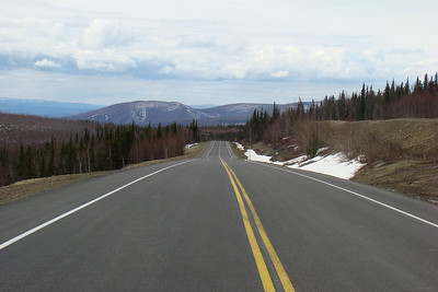 5/13/08  1:10PM - Looking north at MP41 (faintly visible against the snowbank on the right side), one wishes this new, smooth asphalt could go on all the way to Deadhorse.