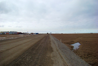 Nearing the end of the Dalton after looping around the end of the airport runway extension.  Prudhoe Bay complex can be seen far across Colleen Lake.