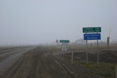 8/10/08  7:12 AM - Heading back south toward Fairbanks, these signs just south of the airport mark the beginning of the long ride home.