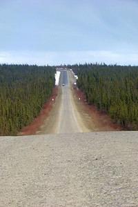 A sight that brings joy to the motorcyclist's heart - PAVEMENT!  Southbound, it begins at Mile 49.2 (actually 49.5 miles from Mile 0) and extends for 12 beautiful miles before gravel again.