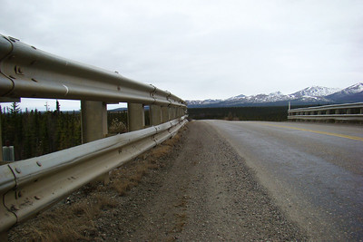 These heavy duty guardrails protect the pipeline below from the miscalculations of drivers passing overhead.  Don't recall ever seeing guardrails this skookum, even on high bridges.  But a hole in the pipeline - even a small one - could result in millions of dollars in damage and lost revenue.