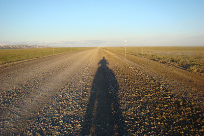 With the bike pointed due south according to the GPS, at 1:00 AM Daylight Time, my shadow stretches out a long way with the sun low in the northern sky.