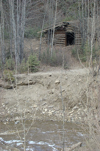 This old log cabin sits along Gold Creek at MP197, on the west side of the road.