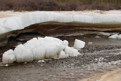 "5/13/08 8:05AM - The ice in this stream (a branch of Gold Creek, at about Mile 196.5) had apparently been pushed up into a dome at one time, then undercut by spring meltoff to leave a dome of ice, some 18"" to 24"" thick."