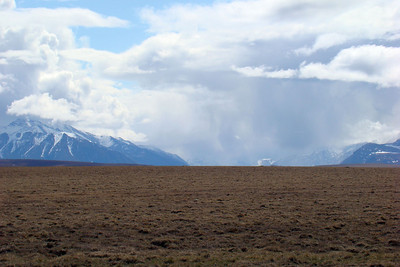 Clouds dumping rain in a valley far to the east of the Dalton Hwy.  The sunshine under which I am riding is much better!