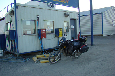 7/5/08 12:07 AM - Filling up at Colville, Inc. - the Tesoro distributor at Deadhorse.  Not much activity at that hour, and there was a cold wind blowing off the ocean, so I turned around and headed back south.