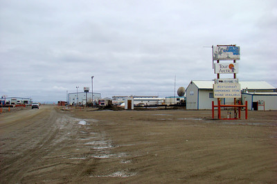 By turning left at the Colleen Lake tee and following the road curving right along the lake shore, then turning left toward the airport, you come to the Arctic Caribou Inn here on the right.