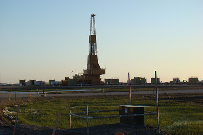 7/5/08 12:17AM - About the only activity I witnessed, aside from a couple of vehicles driving up and down the road, was at this drilling rig where I could see the block rising and falling, indicating some drilling going on.  This is on Drill Site 12, in the middle of Deadhorse.