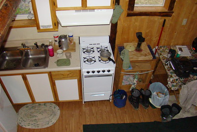 The small, but utilitarian, cabin kitchen as seen from the loft.