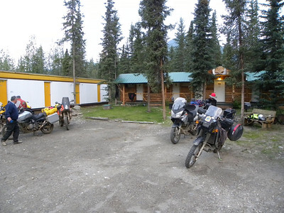 July 1, 2010 4:12 AM - Getting packed for an early start to Deadhorse.  My riding partner and I (the two bikes on the right) were not too surprised to see the other party of riders - also headed for Prudhoe Bay - up and getting ready to leave as early as we were.  The log-sided structure behind our bikes is where we stayed, and the ATCO building on the left appears to be headed for the same treatment.  There is a kitchen out of sight to the right, and a separate log cabin farther to the right beyond that.