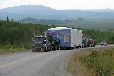 July 11, 2009 - We were told this was a 150 ton load, and could believe it the way the four Kenworths were bellowing as they moved the module up this hill around Mile 108.