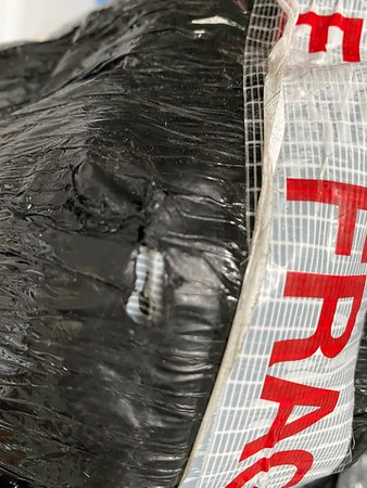 damaged packaging:hide tear