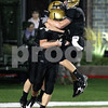 KATE WEBER CARLSON | kcarlson@daily-chronicle.com<br /> Teammates celebrate with Sycamore's Tom Hensley following his touchdown against DeKalb Friday night at Huskie Stadium.
