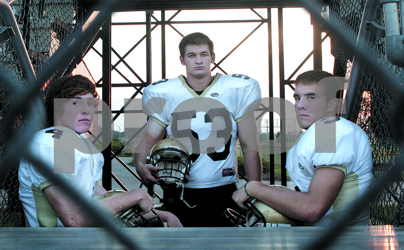 Date: 8/7/2007<br /> Location:  Sycamore, Illinois<br /> <br /> Caption:  Sycamore Spartans senior leaders wide receiver Will Strack, left, tackle Jason Schepler, center, and linebacker Kevin Sabock look to improve on their team's 3-6 record. Chronicle photo ERIC SUMBERG