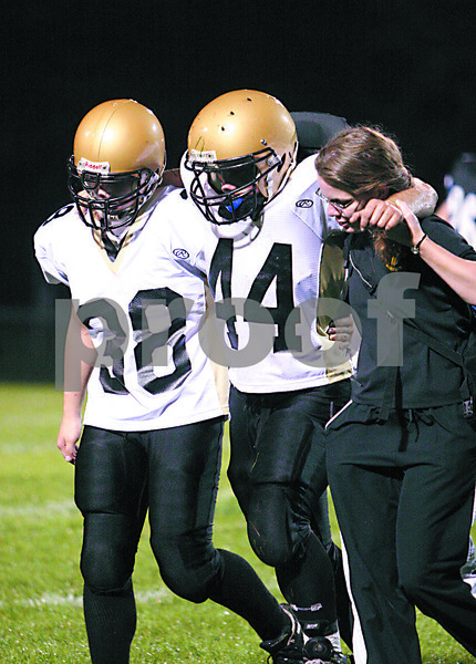 Chronicle photo CURTIS CLEGG<br /> #44 helped off the field