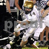 KATE WEBER CARLSON | kcarlson@daily-chronicle.com<br /> Sycamore's Tom Hensley blocks a tackle during a drive Friday against Kaneland.
