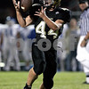 KATE WEBER CARLSON | kcarlson@daily-chronicle.com<br /> Sycamore's Tom Hensley bobbles the ball but completes the throw and scores a touchdown Friday against Burlington Central at Sycamore High School.