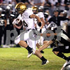 KATE WEBER CARLSON | kcarlson@daily-chronicle.com<br /> Sycamore's Tom Hensley dodges several Kaneland defenders including Ben Bradford Friday night for a touchdown at Kaneland High School.
