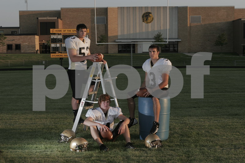 Date: 8/7/2007<br /> Location:  Sycamore, Illinois<br /> <br /> Caption:   Chronicle photo ERIC SUMBERG<br /> <br /> Summary: Will Strack, Kevin Sabock and Jason Schepler of the Sycamore Spartans football team
