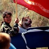 George the Pit Bull - 2001 (July 4) - Age 8 - George participates in the Storm Mountain Independence Day Parade with comrade Alex (age 11) - Drake, CO