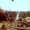 Yaden, Dan & Julie - 1978 (April) - Looking south on Ninth Avenue during the Ninth Avenue International Festival - View is from window of our 30th floor apartment at Manhattan Plaza - 42nd Street & 9th Avenue - New York City, NY (World Trade Center towers in background)