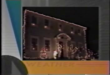 Video Archive Clip 1993 (12) - Yaden, Dan & Julie - Christmas decorations shown during Channel 68 weather report - Park Avenue West Home - Mansfield, OH - Mixed Relations Series (2 min 5 sec)