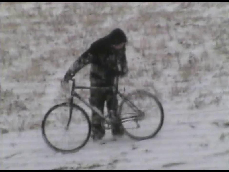 Video Archive Clip 2001 (Jan) - Yaden, Dan & Julie - Age 46 -  Weird sledding on Storm Mountain - Jake (age 16) and Steve (age 12) try pulling Santa's sleigh down a snowy slope with a bicycle - Storm Mountain home - Drake, CO - Original VHS Series (4 min 13 sec)