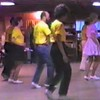 "Video Archive Clip 1987 (Oct) - Yaden Clogging - Julie (age 33, front row in yellow shirt/black skirt), Danny (age 9, front row far end), and Dan (age 33, 2nd row in yellow shirt/white pants) dance the ""Shout"" routine with instructor Dave Roe - Tri-Cities Clogging Workshop - Richland, WA (3 min 38 sec)"