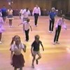 """Video Archive Clip 1987 (July) - Yaden Clogging - The Yaden clan dances  the """"Cajun Moon"""" routine at the Moxee Grange Hall Clogging Dance - Moxee, WA - Clogging Memoirs Series (3 min 31 sec)<br /> <br /> Matthew (age 6, front row striped shirt/white shorts)<br /> Danny (age 9, 2nd row middle, white shirt/dark pants)<br /> Dan, Sr. (age 33, 3rd row far right, blue shirt/dark pants)<br /> Julie (age 33, back row left, blue shirt/dark skirt)"""