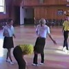 """Video Archive Clip 1987 (Aug) - Yaden Clogging - Dan & Julie (both age 33) practice the """"New York, New York"""" routine with the Silver Creek Cloggers - Moxee Grange Hall - Moxee, WA - Clogging Memoirs Series (1 minutes 31 sec)<br /> <br /> Question:  How many choreographers does it take to screw up the """"New York, New York"""" routine?<br /> <br /> Answer:  You can't screw up the """"New York, New York"""" routine......."""