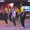 "Video Archive Clip 1987 (Oct) - Yaden Clogging - Julie (age 33, 2nd row in yellow shirt/black skirt), Danny (age 9, front row middle), and Dan (age 33, 3rd row in yellow shirt/white pants) dance the ""Axel F"" routine with instructor Dave Roe - Tri-Cities Clogging Workshop - Richland, WA (3 min 4 sec)"
