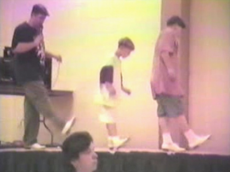 "Video Archive Clip 1996 (Aug) - Yaden, Jacob & Steven - Instructor Jeff Driggs invites Jacob (age 11) and Steven (age 8) up to the stage to help demonstrate his ""Pick Up The Fiddle"" routine - Labor Day Weekend Clogging Workshop - Columbus, OH - Clogging Memoirs Series (3 min 37 sec)"