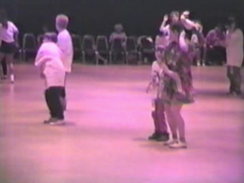 "Video Archive Clip 1996 (Apr) - Yaden Clogging - Julie (age 42), Jacob (age 11) & Steven (age 7) dance to the ""Macarena"" - Clogging Workshop - Toledo, OH - Clogging Memoirs Series (2 min 13 sec)"