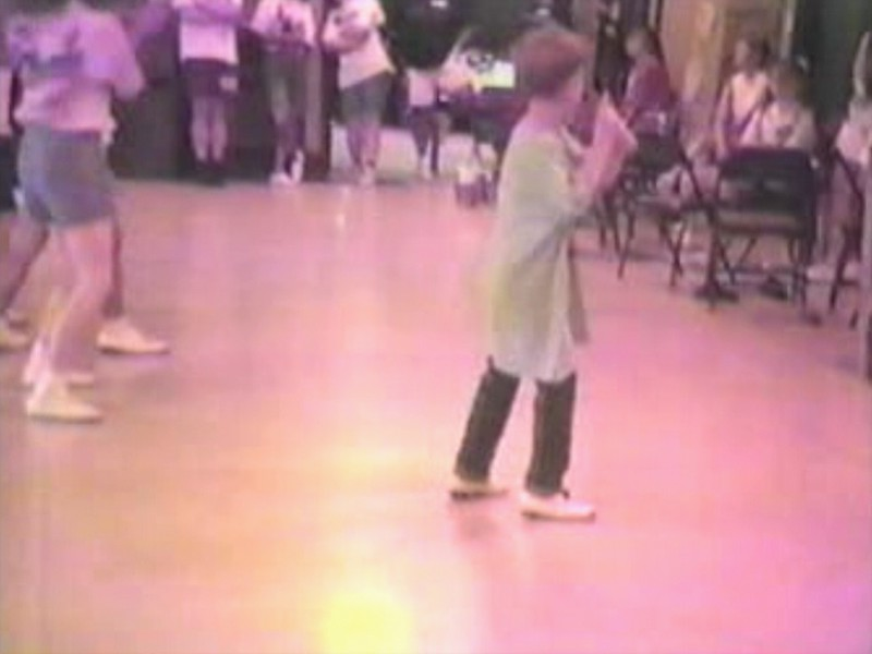 "Video Archive Clip 1996 (July) - Yaden, Steven R. - Steven (age 8) learning the ""Mission Impossible"" routine by instructor Josh King - Jeff Parrott Clogging Workshop - Somerset, KY - Clogging Memoirs Series (2 min 48 sec)"