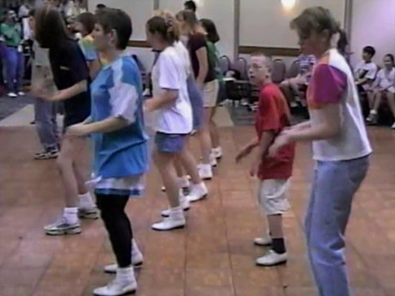 "Video Archive Clip 1998 (May 23) - Yaden Clogging - Julie (age 44, blue top/black tights) & Steven (age 10) learn the ""Gettin' Jiggy Wit It"" routine - Memorial Day Weekend Clogging Workshop - Columbus, OH - Clogging Memoirs Series (3 min 2 sec)"