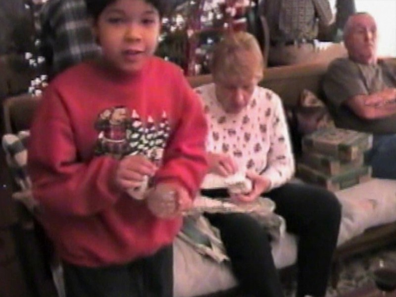 Video Archive Clip 1998 (Dec 23) - Yaden, Dan & Julie (both age 44) - Christmas Tree decorating with Grandpa Dave & Grandma Betty - 611 Park Avenue West - Mansfield, OH - Dave Yaden, Sr. (age 77), Betty [Shaw] Yaden (age 70), Danny (age 20, with U.S. Marines in the Persian Gulf), Matthew (age 17, not present), Jacob (age 14), Steven (age 10), Alex (age 8) - Original VHS Series (3 min 53 sec)