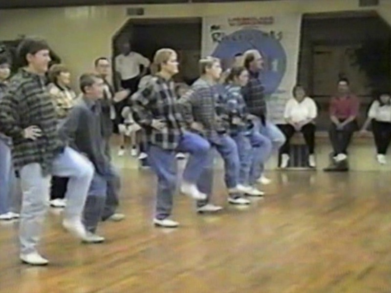 Video Archive Clip 1998 (Nov 14) - Yaden Clogging - Julie (age 44, far left in preview image), Jake (age 14, third from right), and Steve (age 10, next to Julie) perform with the rest of the Free Spirit Cloggers in a medley of Jeff Driggs routines as a tribute to the Hall of Fame clogger/instructor/choreographer - Free Spirit Cloggers Springlake Clogging Workshop - Akron, OH - Clogging Memoirs Series (8 min 50 sec)