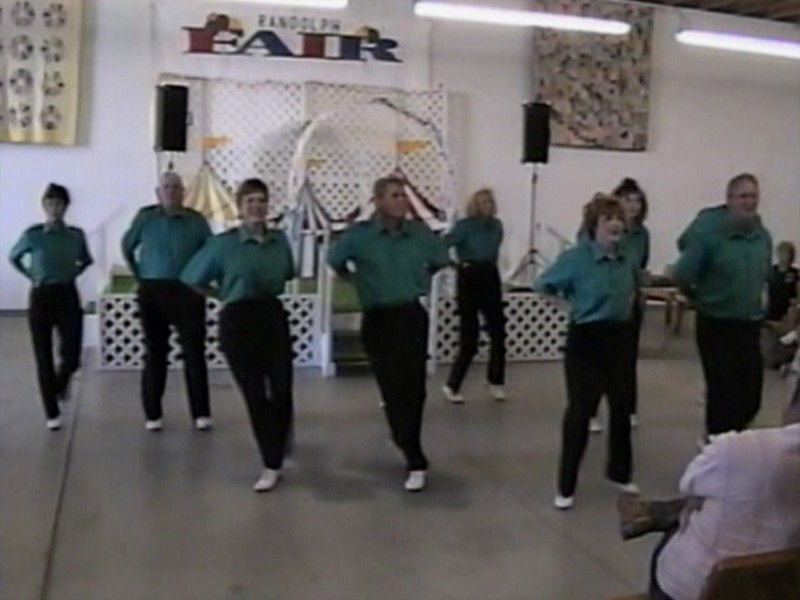 "Video Archive Clip 1998 (Aug 26) - Yaden Clogging - Dan & Julie (both age 44, center left in preview frame) dance the ""Marty Stuart Visits The Moon"" routine - Free Spirit Cloggers Performance at Randolph Fair - Randolph, OH - Clogging Memoirs Series (3 min 2 sec)"