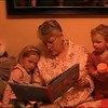 Video Archive Clip 2008 (Dec 25) - Yaden Family - Christmas Day - Matt records Grandma Julie reading to Jaycene (age 3) and Jacob (age 19 mos) - Fire Rock Place home - Loveland, CO - Mixed Relations Series (2 min 57 sec)