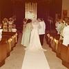 Julie (Schreiner) Yaden - August 31, 1974 - Age 20 - Wedding day photo - Walking down the aisle with parents Mark (Bud) and Betty Schreiner - Holy Redeemer Catholic Church - Yakima, WA