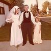 Julie (Schreiner) Yaden - August 31, 1974 - Age 20 - Wedding day photo with Mark (Bud) Schreiner (father) and niece Stephanie Schreiner - Holy Redeemer Catholic Church - Yakima, WA