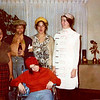 Julie Yaden (yellow hat) - October 31, 1975 - Age 21 - Halloween - Some staff from the Virgina Mason Medical Clinic go trick or treating at their Doctor's homes - Home of Dr. Robert Nielsen - Seattle, WA<br /> <br /> L to R:  Carolyn Sannar, Nancy Becker, Julie Yaden, Gail Flitcraft, Robin White (wheelchair)