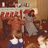 Julie Yaden (back, sitting in chair) - 1978 (Dec) - Age 24 - With Danny (standing right, age 8 mos) during Christmastime visit at the Selah farmhouse - Also in picture is Danny's Great Aunt Evelyn (back center on knees) and other family members - Selah, WA
