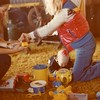 Julie Yaden - 1978 (December) - Age 24 - Danny (age 8 mos) sports a red bow (center floor) as Julie (left) and cousin Stephani Schreiner figure out a new Christmas toy - Mark & Betty Schreiner Home - Yakima, WA